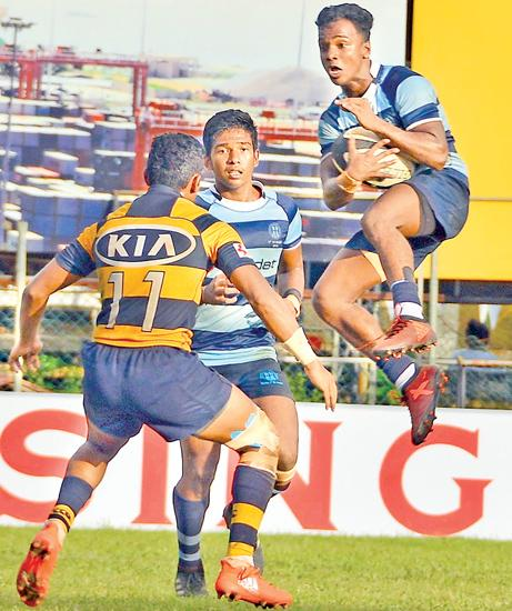 Wesley College winger Paranathiran Mohandas catches a highball in their disrupted match against Royal College Pic: Saman Mendis