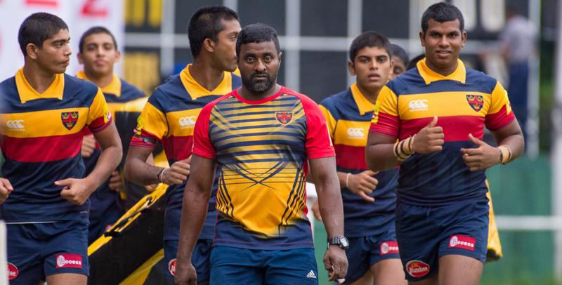 Trinity College's rugby players warm up before their match against St. Peter's College last week.  (Picture courtesy papare)