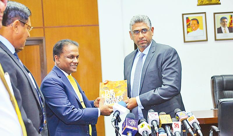 Sri Lanka Cricket president Thilanga Sumathipala (left) presents his annual accounts statement to Sports Minister Faizer Mushtapha at his ministry