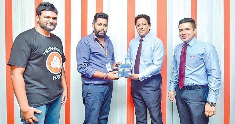 From left: ORELIT Head of IT, Charith Jayanetti and Vice President Upendra Peiris with Singer Sri Lanka Director Operations, Chandana Samarasinghe and Manager, Corporate Sales Waruna Wickramasinghe.
