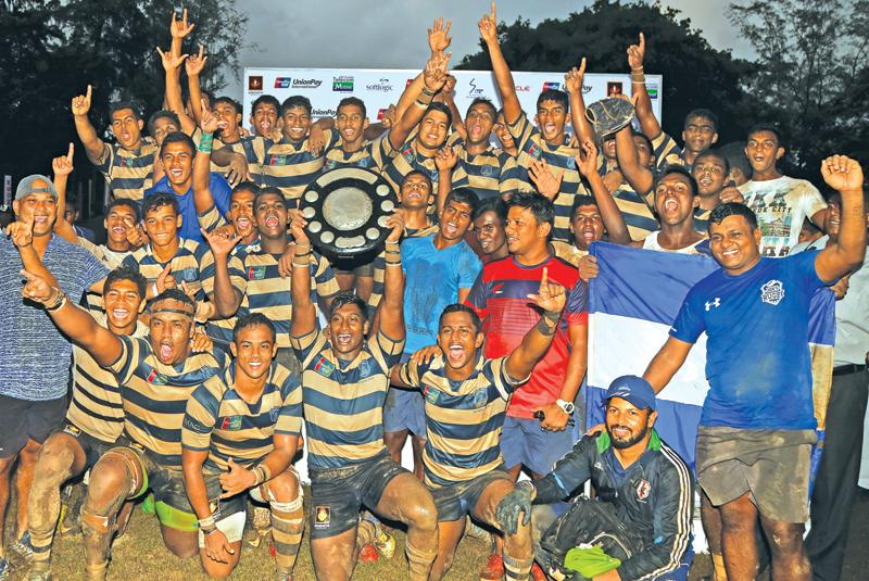 St. Joseph's College players celebrate with the Fr. Basil Wiratunga trophy