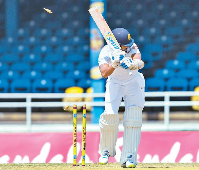 Sri Lanka batsman Roshen Silva is bowled on the third day of the first cricket Test against  the West Indies
