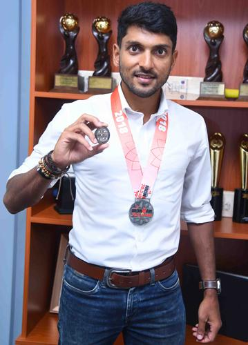 Mithunwith his winning medals.