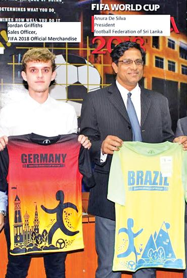 President of the Football Federation of Sri Lanka Anura de Silva (right) and FIFA licensed merchandiser Jordon Griffiths display the T-Shirts