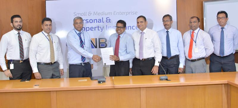 From left: Kelum Wijesooriya– Chief Employee Experience Officer/Assistant General Manager Deposits and Remittances, Sanjay Wijemanne - Deputy General Manager Retail Banking, Deepthi Lokuarachchi - Managing Director/CEO of HNBA and HNBGI, Dilshan Rodrigo - Chief Operating Officer of HNB, Rajive Dissanayake - Chief Strategy Officer/Assistant General Manager Strategy of HNB, Prasantha Fernando - Chief Operating Officer of HNBA, Jude Fernando - Deputy General Manager SME and Nirosh Perera Assistant General Mana