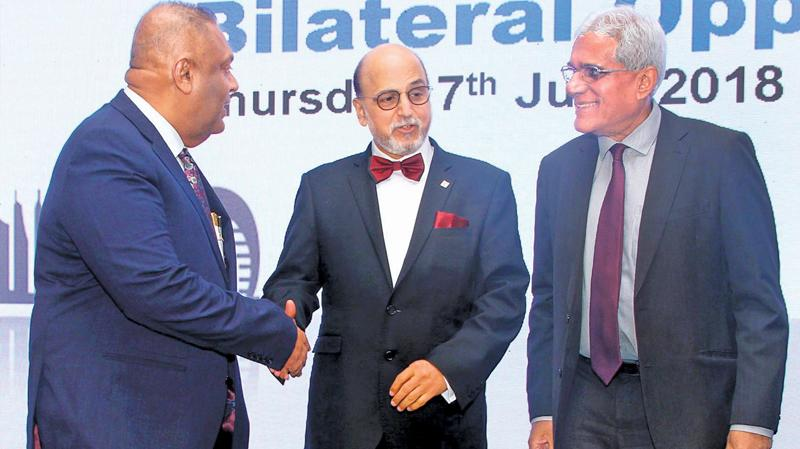 Chief Executive Officer of Doha Bank, Dr. R. Seetharaman with Finance Minister Mangala Samaraweera, and Central Bank Governor, Dr. Indrajith Coomaraswamy at a reception held at the Shangri La Hotel Colombo to mark the opening of Doha Bank Colombo on Thursday. Pic: Sulochana Gamage