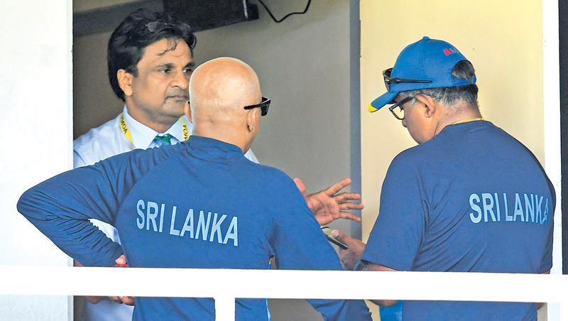 Sri Lanka manager Asanka Gurusinha (right) and coach Chandika Hathurusinghe talk to match referee Javagal Srinath