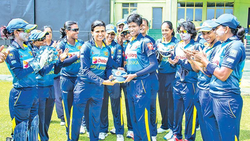 Sri Lanka women's captain Shashikala Siriwardena presents Kaveesha Dilhari (right) with her cap (Pix courtesy papare)