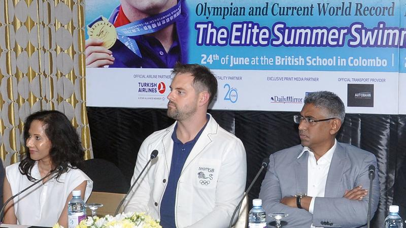 Liam Tancock (centre), Sports Minister Faiser Mushtapha and Tracy Francis (left) Business Development Officer Sports Projects at the launch of the Elite Summer Swimming Camp