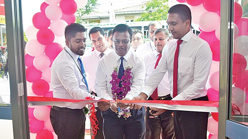 Sumudu Rodrigo - Officer in charge - Puttalam is seen on the left, with Mayura Fernando - CEO and Nilantha Jayanetti,  Senior Assistant General Manager- Marketing, at the ceremonial opening of the Customer Service Centre, Puttalam.