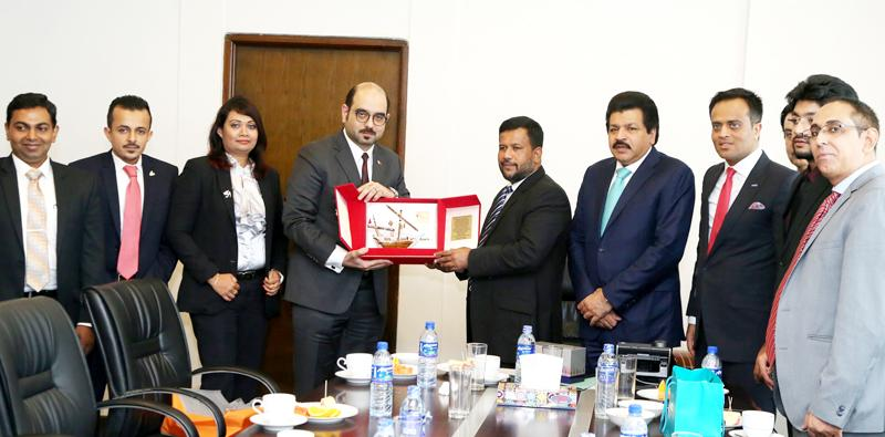The leader of the Bahraini business delegation Mohammed Sajid presents a souvenir to Minister of Industry and Commerce Rishad Bathiudeen.