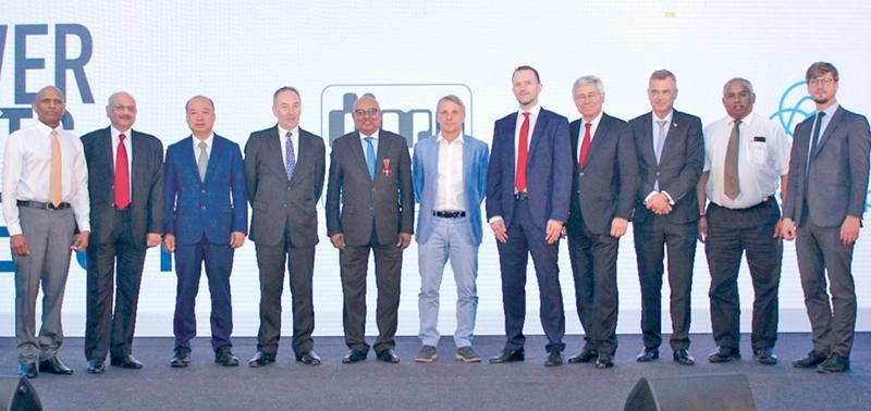From left: DIMO Director Wijith Pushpawela, thyssenkrupp Director Export Sales, Naveen Ratna, thyssenkrupp Business Development Director Ben Mo and Vice President Special Projects Ian Smith, DIMO Chairman and Managing Director Ranjith Pandithage, German Ambassador in Sri Lanka His Excellency Jörn Rohde, thyssenkrupp Commercial Head Worldwide Distributor Business Christoph Karges and Senior Advisor thyssenkrupp Guenther Rittner, The Delegate of German Industry and Commerce in Sri Lanka Andreas Hergenroether
