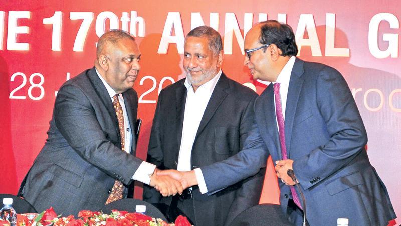 Finance Minister Mangala Samaraweera greets senior officials of the Ceylon Chamber of Commerce, Rajendra Theagarajah and Vish Govindasamy at the 179th AGM of the Ceylon Chamber of Commerce on Thursday. Pic: Sulochana Gamage