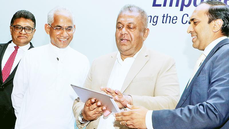 Finance Minister Mangala Samaraweera launches the SME Board at the SEC. State Minister Eran Wickremaratne, SEC Chairman Ranel Wijesinha and CEO Rajeeva Bandaranaike look on.  Pic: Saman Sri Wedage