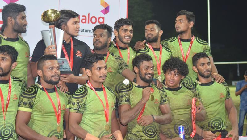 Back row from left: Anuradha Herath, Rohitha Rajapaksa (captain), Mohamed Rizwan, Naveen Hemakankanamge, Ruwan Kumara and Hirantha Perera. Front row from left: Ashan Maduranga, Sasanka Ariyaratne, Lahiru Chinthaka, Sudham Suriyarachchie, Sudharshana Muthuthantri and Nishon Perera after pocketing the inter club rugby Sevens trophy