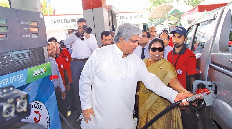 Minister Arjuna Ranatunga dispenses Euro 4 fuel from the first Euro spec fuel dispenser at C.F. De Mel & Sons Filling Station in Colombo 2. Deputy Minister Anoma Gamage and CPC Chairman Dhammika Ranatunga were also present. Pic: Shan Rambukwella