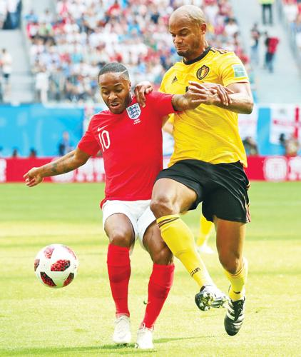 Vincent Kompany (right) from Belgium competes for the ball against England's Raheem Sterling