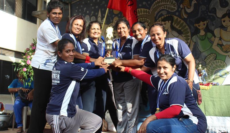 The champion Meththa team comprising Udayangani, Shiromi, Dilani, Sadali, Hansi, Nisansala and Jayathri pose with their trophy presented by distinguished old girl Rohini Yapa