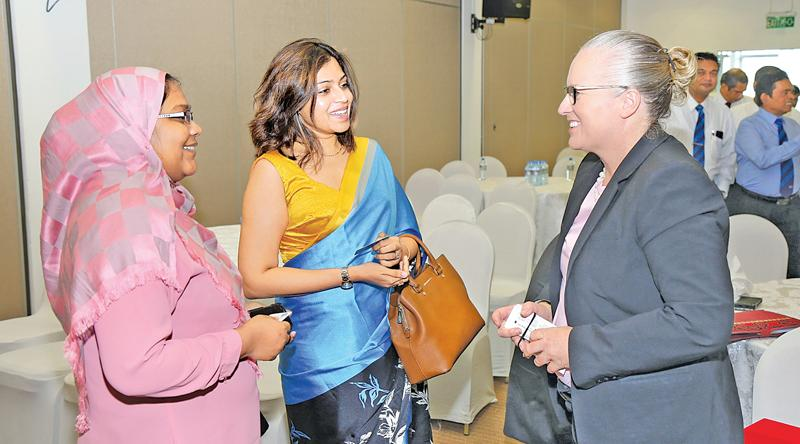 IFAC President Rachel Grimes in conversation with members of CA Sri Lanka during the forum.