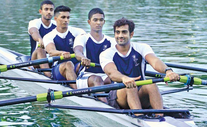 A four-man team from the Colombo Rowing Club row their way to victory on the waters of the Beira Lake Pic: Saman Mendis