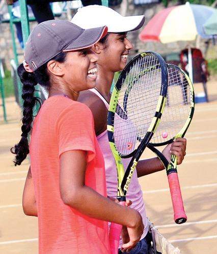 Anika (in white cap) and Alana Seneviratne after their win
