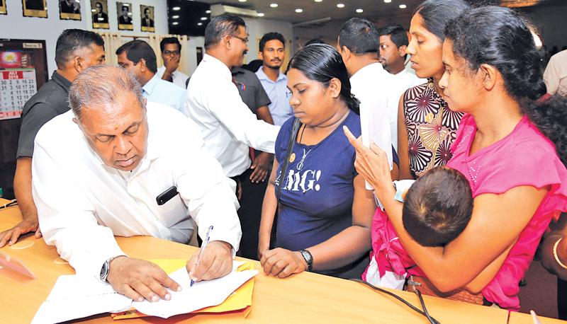 Finance Minister Mangala Samaraweera taking the burden off  debt-affected families by providing written assurances that the Govt. would write off their loans