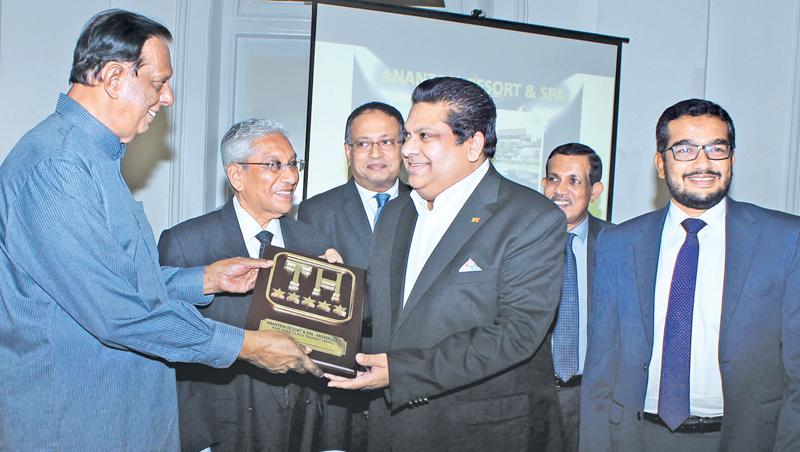 A hotelier receives a classification plaque from Minister Amaratunga.  Pic: Saliya Rupasinghe