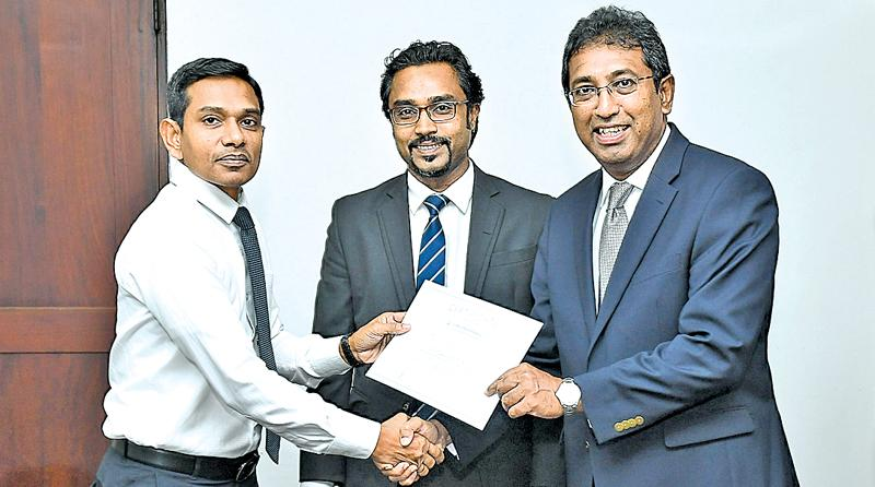 Deputy Managing Director of Berendina Micro Investments Co. LtdCharith Fernando, receiving the acknowledgement certificate for signing the Code of Conduct . Picture by Chaminda Niroshana