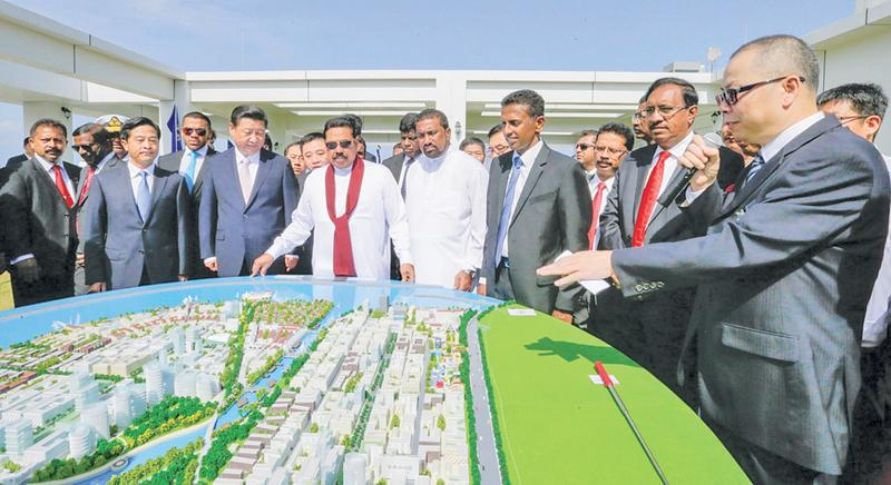 Sauce for the goose: Former President Mahinda Rajapaksa and Chinese President Xi Jingping inspecting a 3D model of the Colombo Port City in 2014 after inking the deal to build the brand new metropolis on land reclaimed from the ocean facing Galle Face, Colombo. The original agreement signed between Sri Lanka and China provided 20 hectares of free hold land in the newly reclaimed city to China Harbour Engineering Corporation, owned by the Chinese Government. The new Government renegotiated that contract and