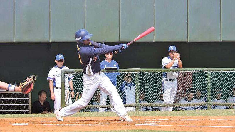 Akalanka Ranasinghe swings his bat