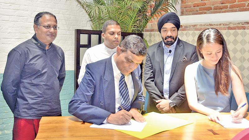 Minister Harin Fernando, Airbnb Country Manager for India  and Sri Lanka, Amanpreet Bajaj, SLTDA Chairman Kavan Ratnayaka and SLTDA  Director General Upali Ratnayaka and Head of Strategic Partnerships,  APAC - Airbnb Thao Nguyen at the signing ceremony. (Pic: Vipula  Amarasinghe)