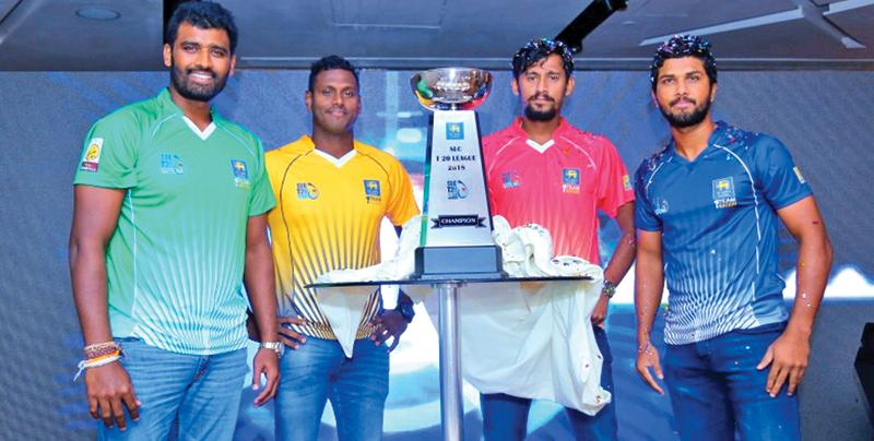 Captains all. From left: Thisara Perera (Dambulla), Angelo Mathews (Kandy), Suranga Lakmal (Galle) and Dinesh Chandimal (Colombo) pose with the lesser SLC T20 trophy they'll play for