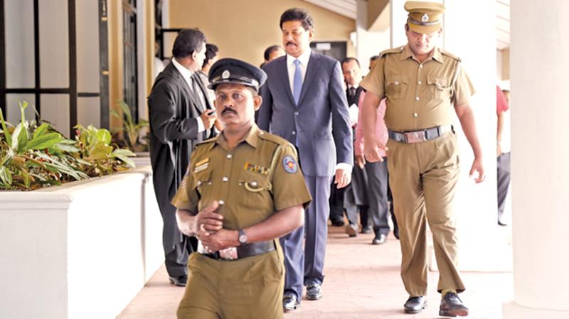 Former Chief of Staff to ex-President Mahinda Rajapaksa, Gamini Senerath being escorted to the Permanent High Court at Bar office, after he appeared before the newly opened Court on Friday, to finalise formalities before being released on bail.  Picture by  Chinthaka Kumarasinghe