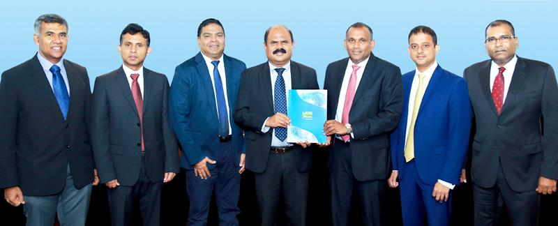 Exchange of the agreement between Sri Lanka Telecom and Mobitel Chairman P. G. Kumarasinghe Sirisena and Citibank the Citi Country Officer Ravin Basnayake. From left: Mobitel Senior General Manager Human Resources / Legal and Regulatory Affairs,Namal Ratnayake, Mobitel Chief Financial Officer Sudharshana Geeganage, Mobitel Chief Executive Officer Nalin Perera, Citibank Director, Head - Corporate and Investment Bank,  Kavinda de Zoysa and Mobitel Senior General Manager Engineering and Operations Rasantha He