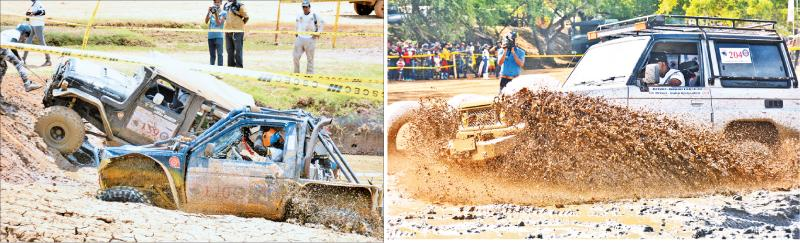 Two competitors attempt to extricate from a mud ditch in the Extreme Class Jeeps event  -Gayan Lakshan competing in the Touring Class Jeeps 3000cc goes through a mud filled area