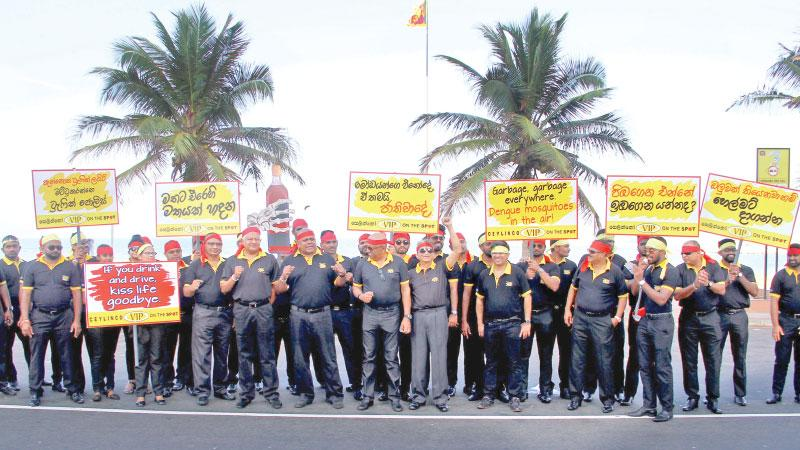 Right way on the highway – Over 1,700 staffers of Ceylinco General Insurance took to the streets in several areas in Colombo on Friday with a unique campaign to educate people and road users on deteriorating civic values and to say NO to child abuse, drug use and sexual  violence. The program will be conducted islandwide. (Pic: Sulochana Gamage)