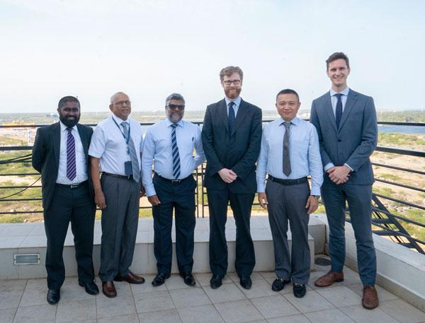 Standing  (from left): Dinidu de Alwis, Political Affairs Officer, British High  Commission, Tissa Wickremasinghe, Chief Operating Officer – HIPG,  Ravindra Jayawickreme (AFNI), CEO Hambantota International Port Services  (HIPS), Tom Burn, Deputy High Commissioner, Ray Ren, CEO of Hambantota  International Port Group, Phil Dickinson, Second Secretary of the  British High Commission.