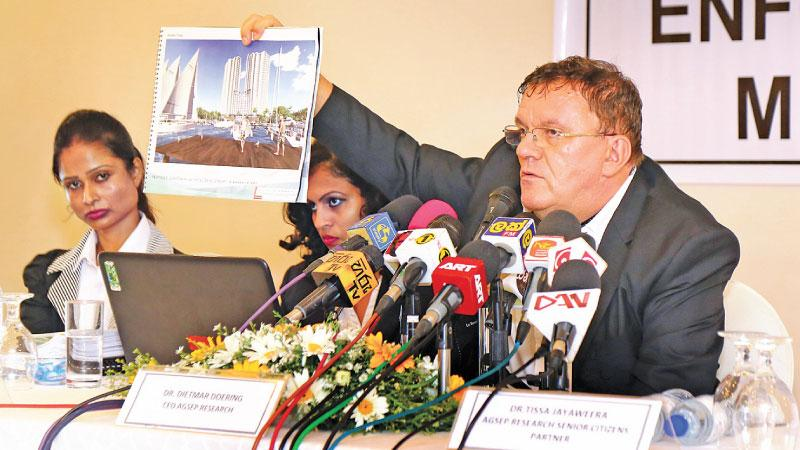 AGSEP Research CEO Dr. Dietmar Doering shows a model marina at the media briefing flanked by TJ Associates Managing Partner Dr. Tissa Jayaweera and other officials of AGSEP Research.