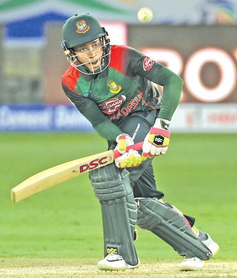 Bangladeshi batsman Mushfiqur Rahim plays a shot during the one day international (ODI) Asia Cup cricket match against Sri Lanka at the Dubai International Cricket Stadium  AFP)