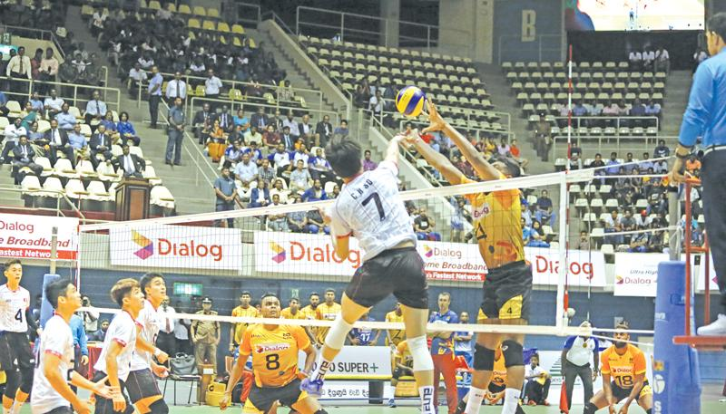 Janitha Surath spikes a point for Sri Lanka in the Asian Challenge Volleyball tournament against Hong Kong yesterday