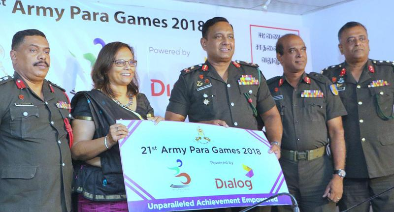Chief Marketing Officer of Dialog Amali Nanyakkara hands over the sponsorship check to President of Army Para Sports Committee Chief of Staff Major General W.B.D.P. Fernando. Picture by Saman Sri Wedage