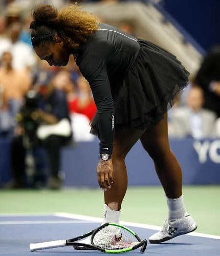 NEW YORK: Serena Williams of the United States throws her racket to the ground in frustration AFP