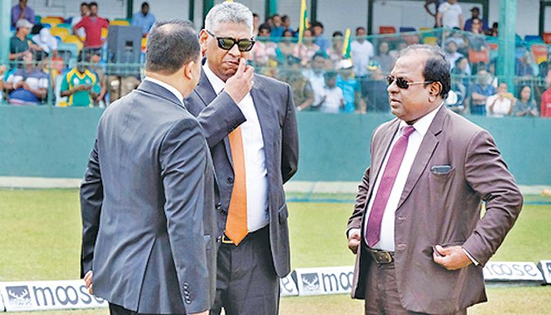 Nero was fiddling while Rome was burning: File photo of Sports Minister Faiszer Mushtapha (centre) and Competent Authority of SLC Kamal Padmasiri (centre) talking to SLC's Ashley de Silva before a fruitless meeting with the ICC last month