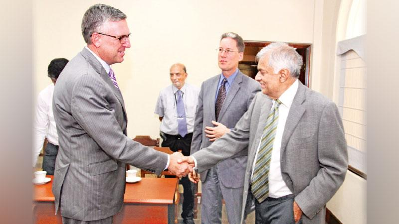 MCC COO Jonathan Nash and Chargé d'affaires ad interim Robert Hilton greets Prime Minister Ranil  Wickremesinghe