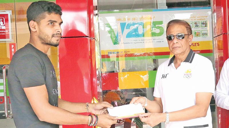 People's Bank Chairman Hemasiri Fernando granting a loan to an  entrepreneur.