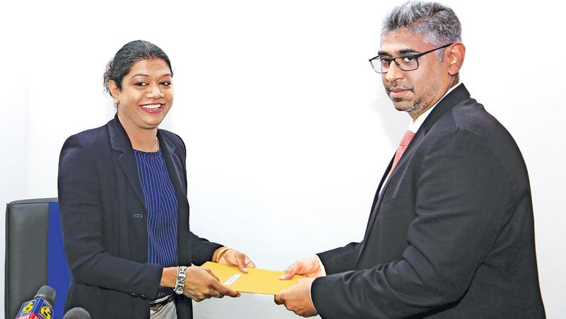 Susanthika Jayasinghe accepts her new appointment from Minister Faiszer Mushtapha