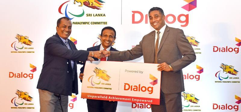 Harsha Samaranayake (right) General Manager, Brand & Media - Dialog Axiata presents the sponsorship to Maj. Gen. Rajith Ampemohotti, President - National Paralympics Committee in the presence of Col. Mahesh Kumara, Asst. Secretary - National Paralympics Committee