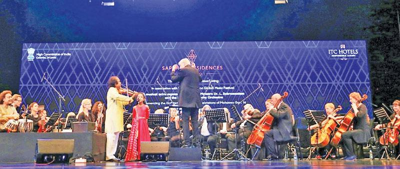 Dr. L. Subramaniam and his granddaughter Mahati Subramaniam along with the Liepājas Symphony Orchestra