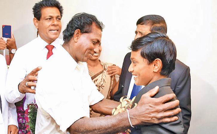 Paarami Fernando is greeted by her father