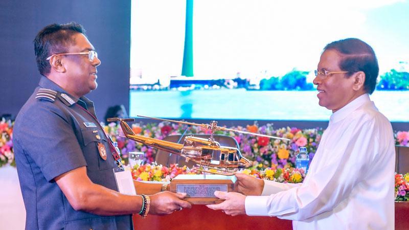 Air Force Commander, Air Marshal Kapila Jayampathy presents a memento to President Maithripala Sirisena